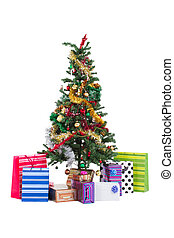 Christmas tree and gifts isolated on white