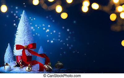 Christmas tree and holidays light decoration on blue background