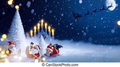 Christmas tree and holidays Santa decoration ornaments; Santa Claus flying in his sleigh against moon sky