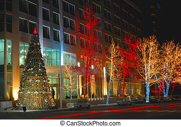 Christmas tree and trees decorated with lights in Baku,...