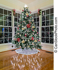 Christmas tree at night in modern room