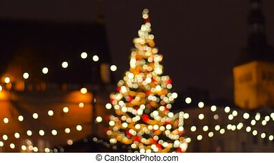 christmas tree at old town hall square in tallinn - holidays...
