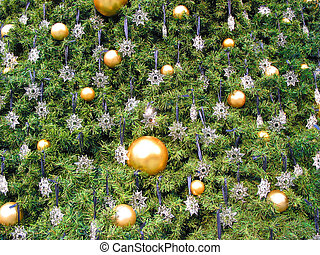 Christmas tree background with gold christmas balls and...