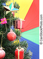christmas tree background with decorations on colorful
