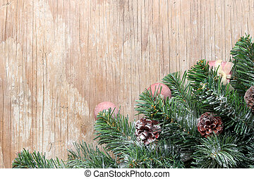 christmas tree background with decorations on wooden board