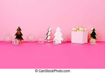Christmas tree balls on a pink background
