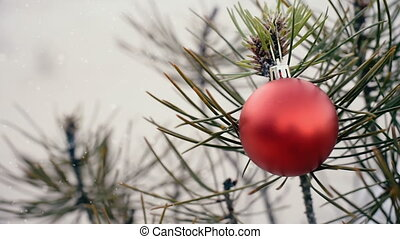 Christmas tree bauble on winter snow background - Christmas...