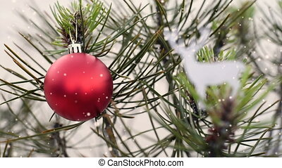 Christmas tree bauble video card in snow landscape -...