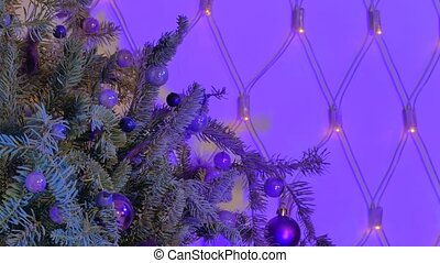 Christmas tree branch decorated with balls