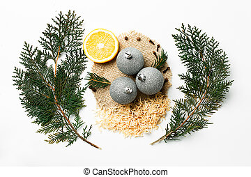Christmas tree branch, lemon, New Year decoration balls isolated on white. Creative concept, space for text, logo. flat lay
