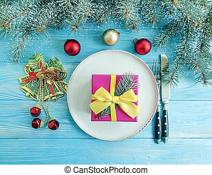 Christmas tree branch, on a blue wooden background