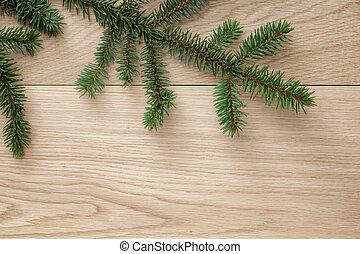 christmas tree branch on oak table