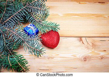 christmas tree branch on the wooden background