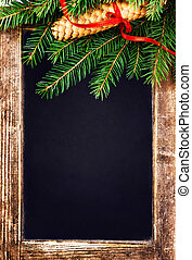 Christmas  Tree Branch on  Vintage Blackboard with cone and red