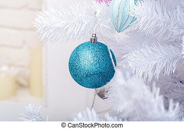 Christmas tree branch with blue ball