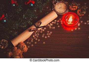 Christmas tree branch with blue balls, a letter with a ribbon, a bear toy, a cone on the table flat lay top view copy space