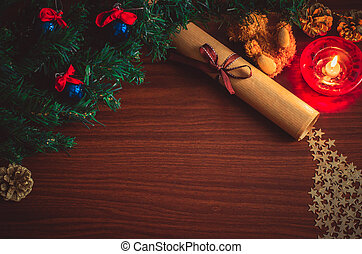 Christmas tree branch with blue balls, a letter with a ribbon, a bear toy, star confetti, a cone on the table flat lay top view copy space