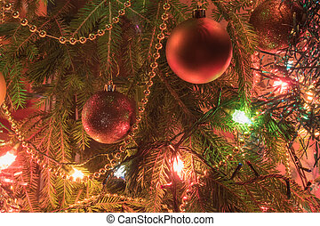 Christmas tree branch with Christmas ballsand tinsel garlands