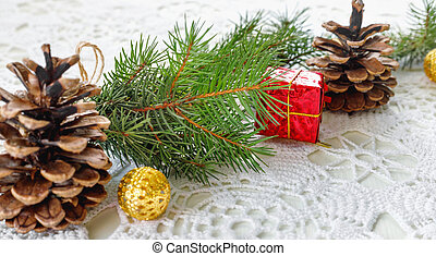 Christmas tree branch with gift in  red box