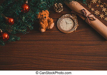 Christmas tree branch with red balls, a letter with a ribbon, a bear toy, a cone on the table flat lay top view copy space