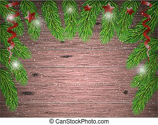 Christmas tree branches on  wood background.