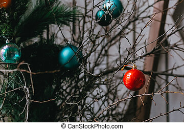 Christmas tree branches with colorful balls