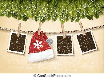 Christmas tree branches with photos and a Santa hat.