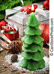 Christmas tree candle on festive background