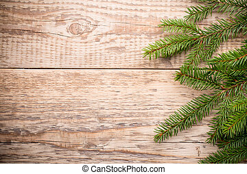 Christmas tree and wooden background.