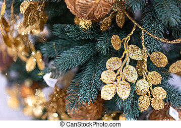 Christmas tree close-up with gold decorations