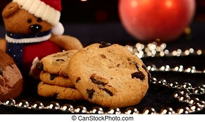 Christmas tree, cookies with decoration, pine cone on black, beads, bokeh, light, garland, cam oves to the left, close up