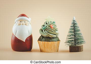 Christmas tree cupcake with santa claus doll and Christmas tree.
