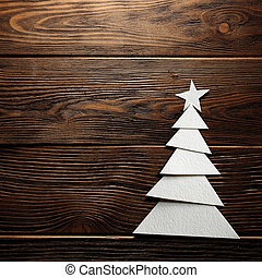 Christmas tree cut out from paper on background - Christmas...