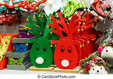Christmas tree decor the store shelf. Toy deer red and green