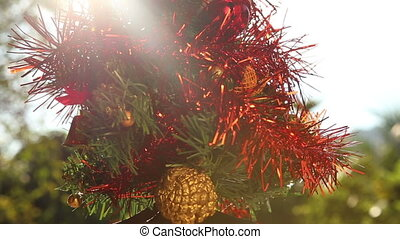 Christmas tree decorated by red rain