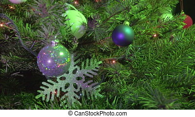 Christmas tree decorated with New Year's balls, snowflakes and a garland