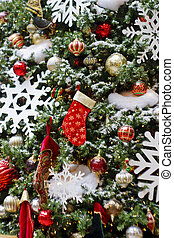 Christmas Tree Decorated with Red Stockings and White Snowflakes