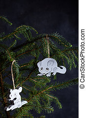 Christmas tree decorated with wooden toys. Two rats are gray and white. Symbol of the new year