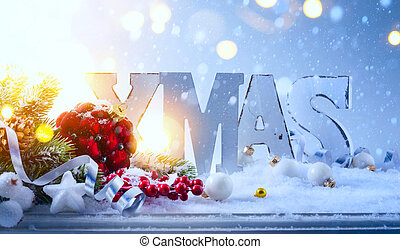 Christmas tree decoration and holidays lights on blue background