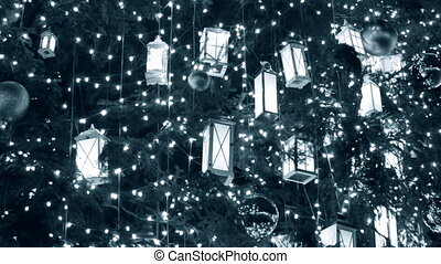 Christmas tree decoration background with a glowing garland. Backdrop Christmas Winter New Year background. White blue color
