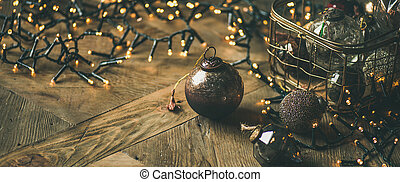 Christmas tree decoration balls in box and light garland
