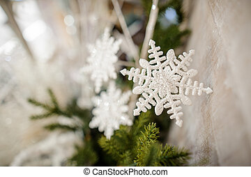 Christmas tree decoration in the form of a white snowflakes