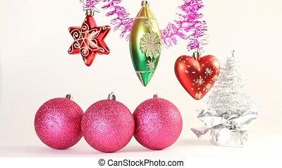 Christmas-tree decoration swing on tinsel, christmas tree...