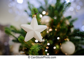Christmas tree decoration toy in the form of a cute white star