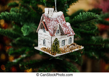 Christmas tree decoration toy in the form of cute little house