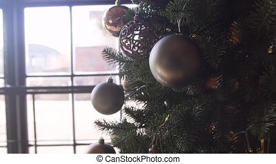 Christmas tree decorations in the studio with christmas and new year interior decoration. Green tree decorated with small glass balls.