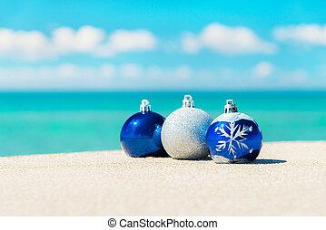 Christmas tree decorations on sea sandy beach - Christmas...