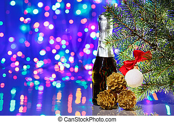 Christmas tree decorations with spruce and champagne on bokeh background