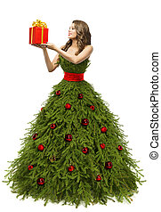 Christmas Tree Dress, Woman holding Present Gift Box, Fashion Model in New Year Gown Isolated over White background