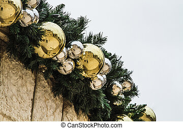 Outdoors christmas decoration, Christmas garland of spruce branches and golden balls in Nazareth near church of the Annunciation, Israel